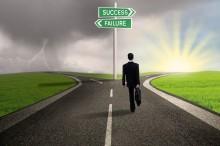 Businessman choosing path to success
