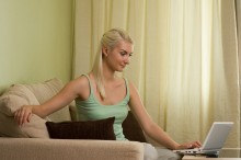 Young woman working on a laptop at home