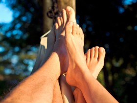 foot of couple on hammock