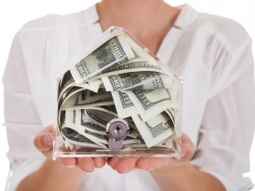 Young Woman Holding A Box Of Currency
