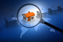 Magnifying glass searching for unique house. Real estate market.
