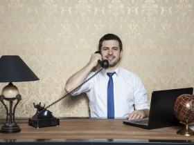 businessman leading cultural telephone conversation