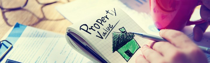 Businessman Notepad Property Value Concept